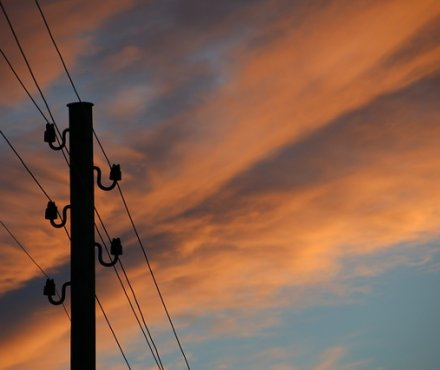 Phone mast against a colourful sky